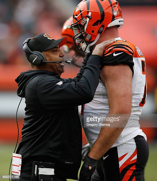 Head coach Marvin Lewis of the Cincinnati Bengals talks with Andrew Whitworth while playing the Cleveland Browns at FirstEnergy Stadium on December 6...