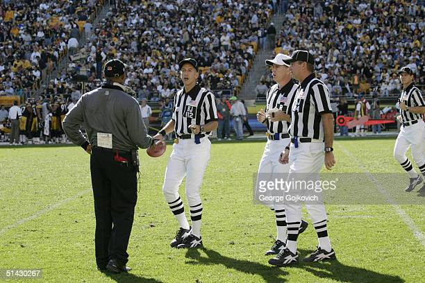Head coach Marvin Lewis of the Cincinnati Bengals talks with back judge Tony Steratore referee Terry McAulay and line judge Mark Steinkerchner during...