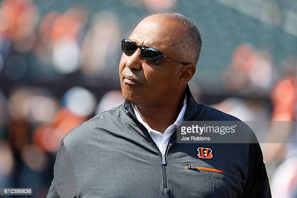 Head Coach Marvin Lewis of the Cincinnati Bengals walks on the field while his players warm up prior to the start of the game against the Denver...