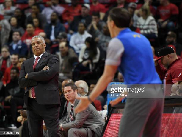 Head coach Marvin Menzies of the UNLV Rebels looks at head coach Eric Musselman of the Nevada Wolf Pack as he yells to officials about not getting a...