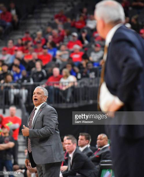 Head coach Marvin Menzies of the UNLV Rebels looks on during his team's game against the Brigham Young Cougars at TMobile Arena on December 15 2018...