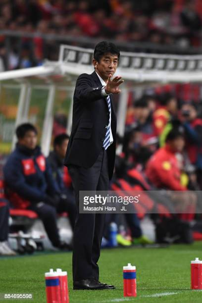 Head coach Masami Ihara of Avispa Fukuoka gestures during the JLeague J1 Promotion PlayOff Final between Nagoya Grampus and Avispa Fukuoka at Toyota...