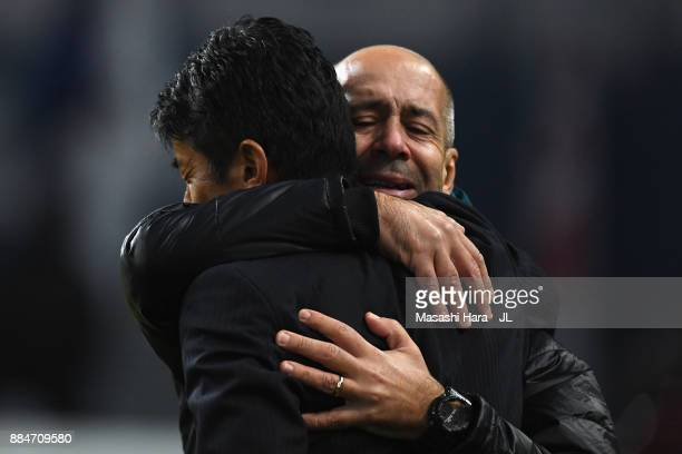 Head coach Masami Ihara of Avispa Fukuoka is consoled by physical coach Flavio after missing the promotion to the J1 after the JLeague J1 Promotion...