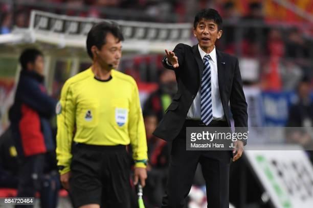 Head coach Masami Ihara of Avispa Fukuoka protests to an assistant referee during the JLeague J1 Promotion PlayOff Final between Nagoya Grampus and...
