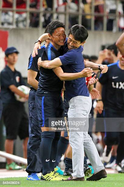 Head coach Masatada Ishii of Kashima Antlers celebrates the JLeague first stage champions after the 20 win in the JLeague match between Kashima...