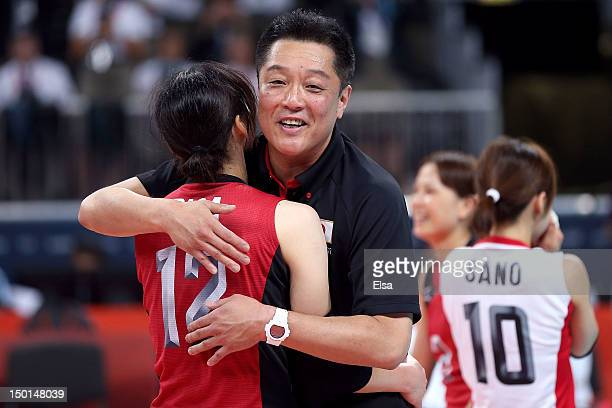 Head coach Masayoshi Manabe and Risa Shinnabe of Japan celebrate after defeating Korea to win the Women's Volleyball bronze medal match on Day 15 of...