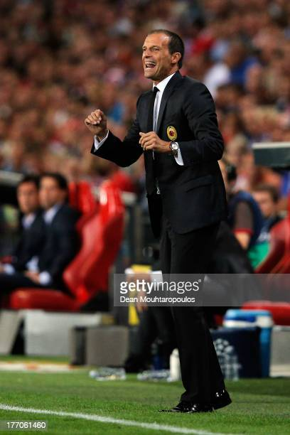 Head coach Massimiliano Allegri of AC Milan gives his team instructions during the UEFA Champions League Playoff First Leg match between PSV...