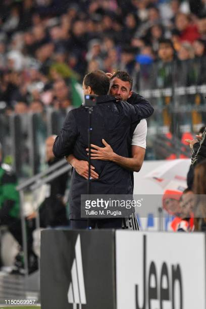 Head coach Massimiliano Allegri of Juventus hugs Andrea Barzagli as he says farewell during the Serie A match between Juventus and Atalanta BC on May...