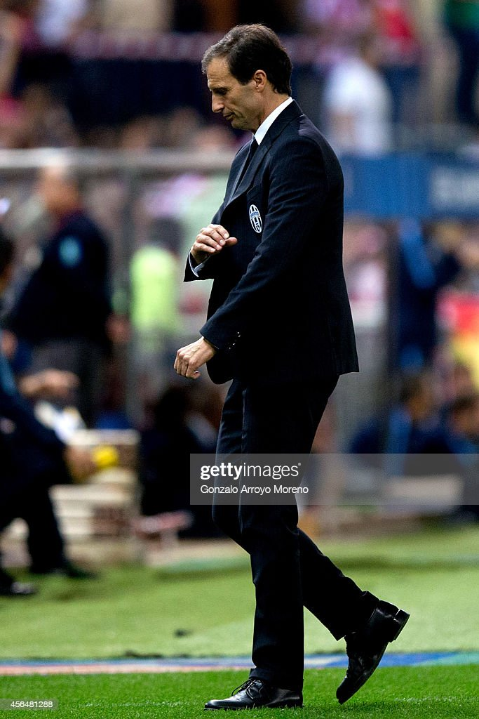 Head coach Massimiliano Allegri of Juventus looks dejected during the UEFA Champions League group A match between Club Atletico de Madrid and Juventus at Vievnte Calderon Stadium on October 1, 2014 in Madrid, Spain.