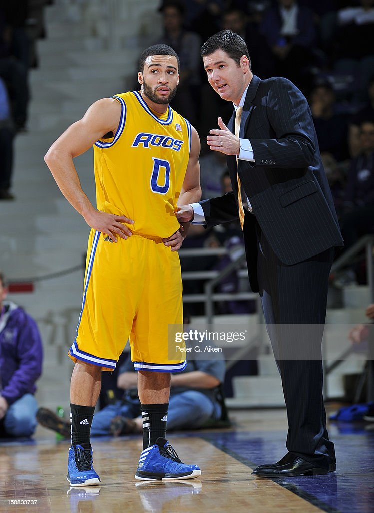 Head coach Matt Brown (R) of the Missouri-Kansas City Kangaroos talks with guard Nate Rogers #0 against the Kansas State Wildcats during the first half on December 29, 2012 at Bramlage Coliseum in Manhattan, Kansas. Kansas State defeated Missouri-Kansas City 52-44.