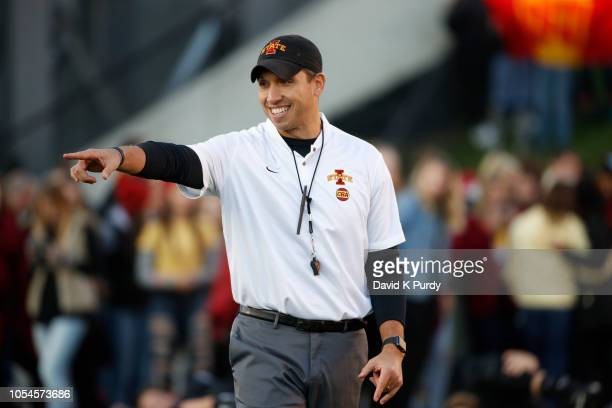 Head coach Matt Campbell of the Iowa State Cyclones coaches during pre game warm ups before game action agains the West Virginia Mountaineers at Jack...