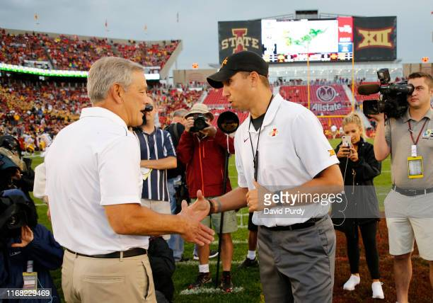 Head coach Matt Campbell of the Iowa State Cyclones, right, and head coach Kirk Ferentz of the Iowa Hawkeyes shake hands at midfield during pregame...