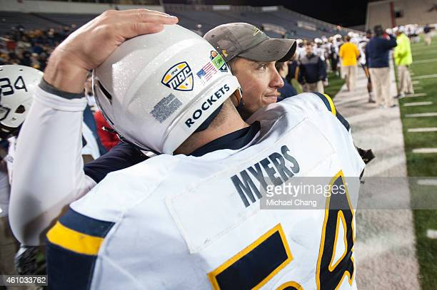 Head coach Matt Campbell of the Toledo Rockets celebrates with offensive lineman Jeff Myers of the Toledo Rockets during their game against the...