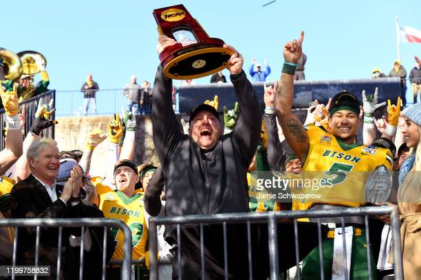 Head Coach Matt Entz and Trey Lance of the North Dakota State Bison celebrate their victory over the James Madison Dukes during the Division I FCS...
