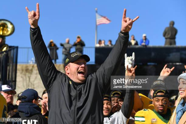 Head Coach Matt Entz of the North Dakota State Bison celebrates their victory over the James Madison Dukes during the Division I FCS Football...