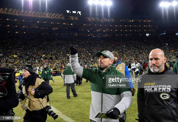 Head coach Matt LaFleur of the Green Bay Packers celebrates as he walks off the field after their 2823 win over the Seattle Seahawks in the NFC...