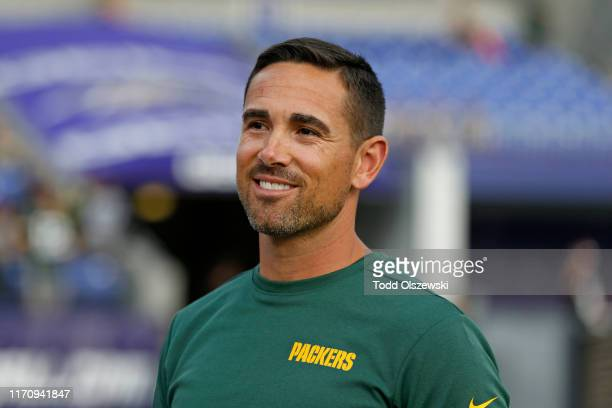 Head Coach Matt LaFleur of the Green Bay Packers stands on the field prior to a preseason game against the Baltimore Ravens at MT Bank Stadium on...
