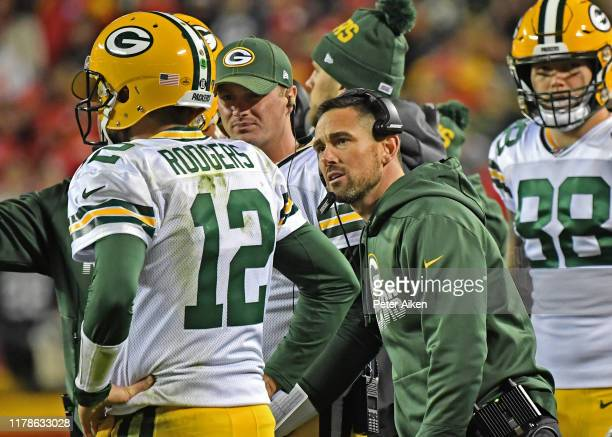 Head coach Matt LaFleur of the Green Bay Packers talks with quarterback Aaron Rodgers of the Green Bay Packers during a time out the second half...