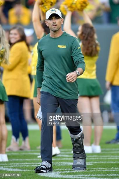 Head coach Matt LaFleur of the Green Bay Packers walks across the field before a preseason game against the Houston Texans at Lambeau Field on August...