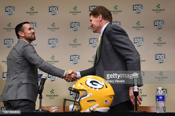 Head coach Matt LaFleur shakes hands with President and CEO Mark Murphy of the Green Bay Packers following a press conference introducing Matt...