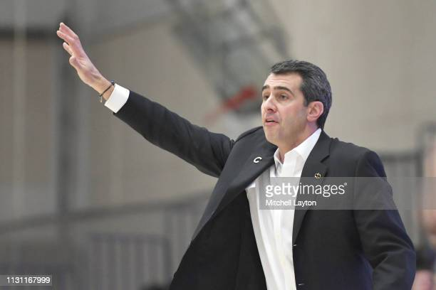 Head coach Matt Langel of the Colgate Raiders signals to his players during a college basketball game against the American University Eagles at...