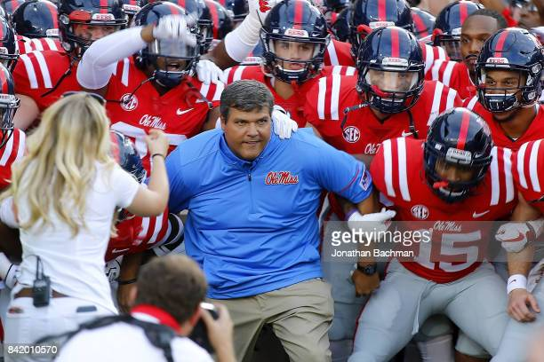 Head coach Matt Luke of the Mississippi Rebels takes the field before a game against the South Alabama Jaguars at VaughtHemingway Stadium on...