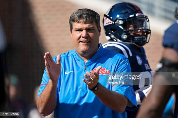 Head Coach Matt Luke of the Ole Miss Rebels watches his team work out before a game against the Arkansas Razorbacks at Hemingway Stadium on October...