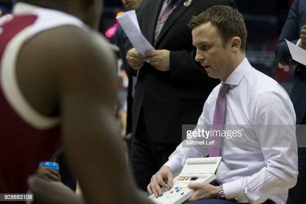 Head coach Matt McCall of the Massachusetts Minutemen talks to his team during a timeout against the La Salle Explorers in the first round of the...