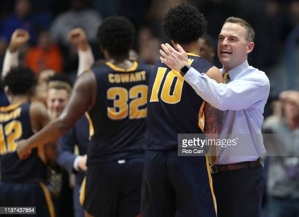 Head coach Matt McMahon of the Murray State Racers celebrates with Tevin Brown after their win over the Marquette Golden Eagles 8364 in the first...