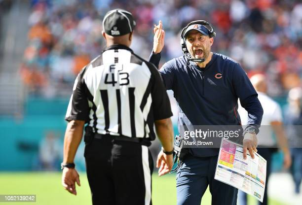 Head coach Matt Nagy of the Chicago Bears argues with field judge Terry Brown during their game against the Miami Dolphins at Hard Rock Stadium on...