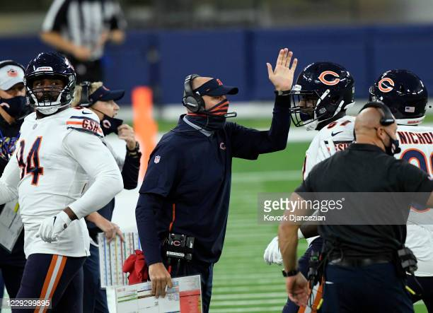 Head coach Matt Nagy of the Chicago Bears congratulates his defense after stopping the Los Angeles Rams during the first half at SoFi Stadium on...
