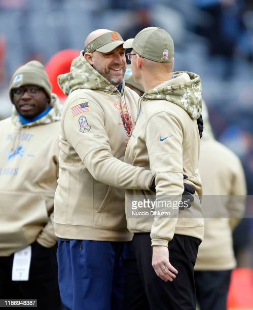 Head coach Matt Nagy of the Chicago Bears hugs offensive coordinator Darrell Bevell of the Detroit Lions prior to a game at Soldier Field on November...