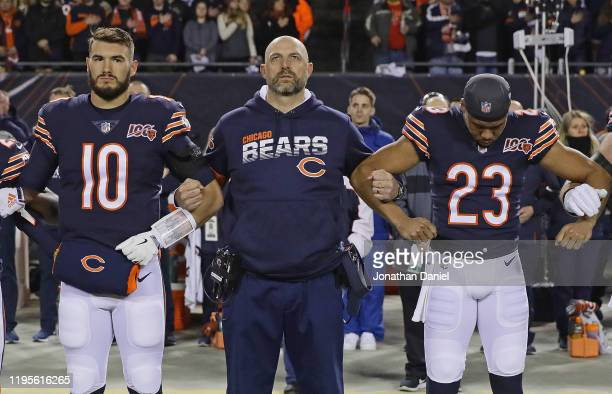 Head coach Matt Nagy of the Chicago Bears stands during the National Anthem with Mitchell Trubisky, and Kyle Fuller before a game against the Kansas...