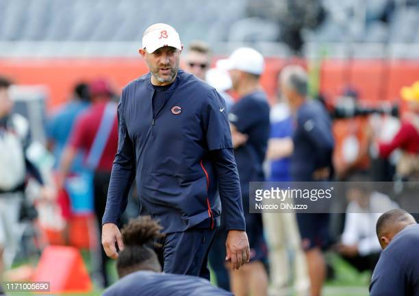 Head coach Matt Nagy of the Chicago Bears talks to his players during warmups prior to a preseason game against the Tennessee Titansat Soldier Field...