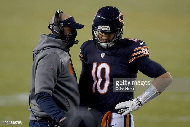 Head coach Matt Nagy of the Chicago Bears talks with Mitchell Trubisky in a time out against the Green Bay Packers during the second quarter in the...