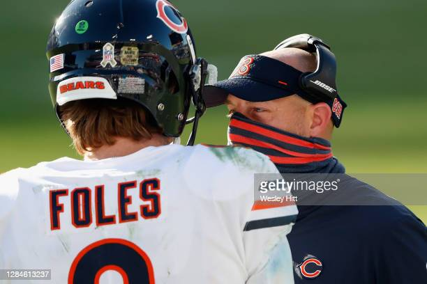 Head coach Matt Nagy of the Chicago Bears talks with quarterback Nick Foles during the third quarter against the Tennessee Titans at Nissan Stadium...