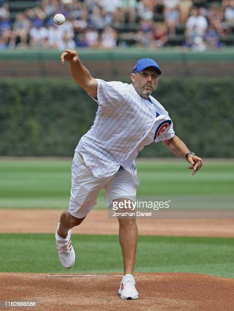 Head coach Matt Nagy of the Chicago Bears throws a ceremonial first pitch before the Chicago Cubs take on the Cincinnati Reds at Wrigley Field on...
