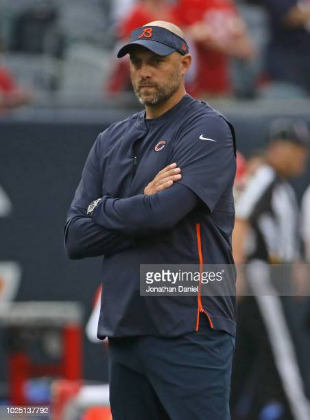 Head coach Matt Nagy of the Chicago Bears watches warmups before a preseason game against the Kansas City Chiefs at Soldier Field on August 25 2018...