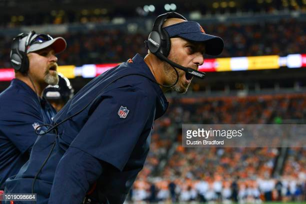 Head coach Matt Nagy of the Chicago Bears yells congratulations after a nice play against the Denver Broncos during an NFL preseason game at Broncos...