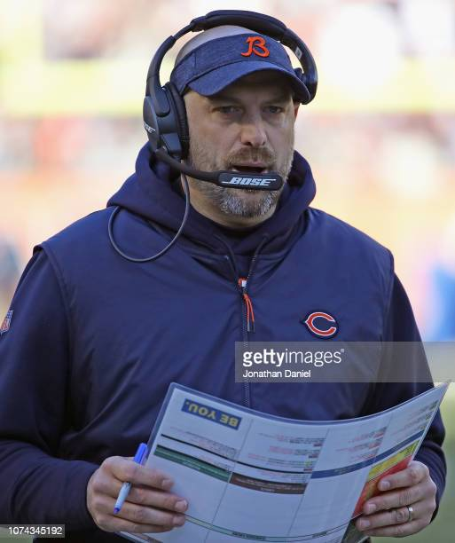 Head coach Matt Naty of the Chicago Bears talks with a coach during a game against the Green Bay Packers at Soldier Field on December 16 2018 in...