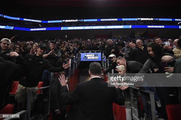 head coach Matt Painter of the Purdue Boilermakers exits the court after the Purdue Boilermakers beat the Butler Bulldogs in the second round of the...