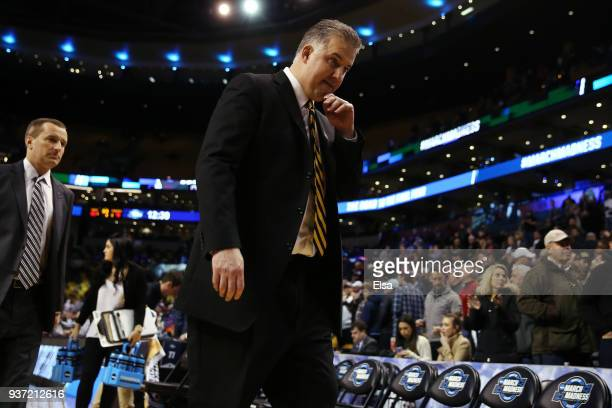 Head coach Matt Painter of the Purdue Boilermakers leaves the court after being defeated by the Texas Tech Red Raiders 7865 in the 2018 NCAA Men's...
