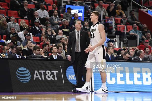 Head coach Matt Painter of the Purdue Boilermakers talks with Isaac Haas of the Purdue Boilermakers in the first round of the 2018 NCAA Men's...