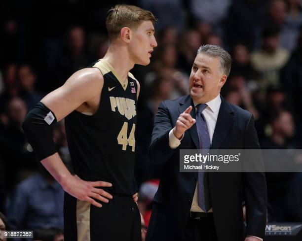 Head coach Matt Painter talks with Isaac Haas of the Purdue Boilermakers during the game against the Ohio State Buckeyes at Mackey Arena on February...
