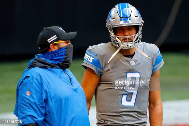 Head coach Matt Patricia and Matthew Stafford of the Detroit Lions look on during warmups prior to the game against the Atlanta Falcons at...