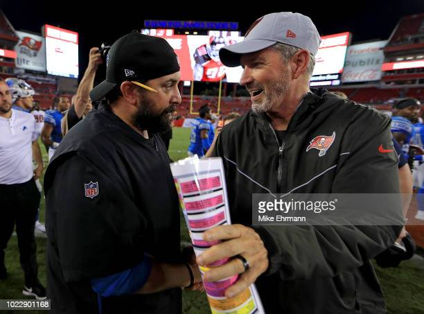 Head coach Matt Patricia of the Detroit Lions and head coach Dirk Koetter of the Tampa Bay Buccaneers shake hands following a preseason game at...