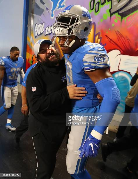 Head coach Matt Patricia of the Detroit Lions gets a hug from Marquis Flowers after a 2610 win over the New England Patriots at Ford Field on...