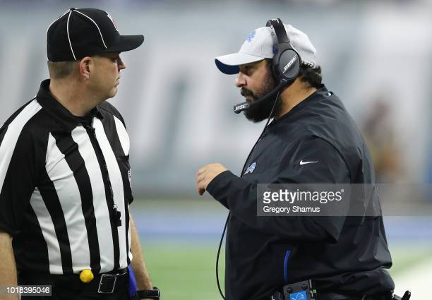 Head coach Matt Patricia of the Detroit Lions talks with a official while playing the New York Giants during a pre season game at Ford Field on...