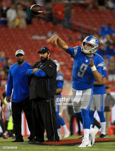 Head coach Matt Patricia of the Detroit Lions watches Matthew Stafford of the Detroit Lions warm up during a preseason game against the Tampa Bay...