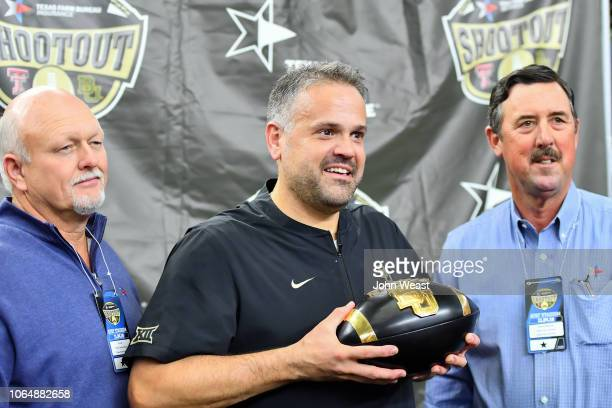 Head coach Matt Rhule of the Baylor Bears is presented the Shootout trophy for winning the game against the Texas Tech Red Raiders on November 24...